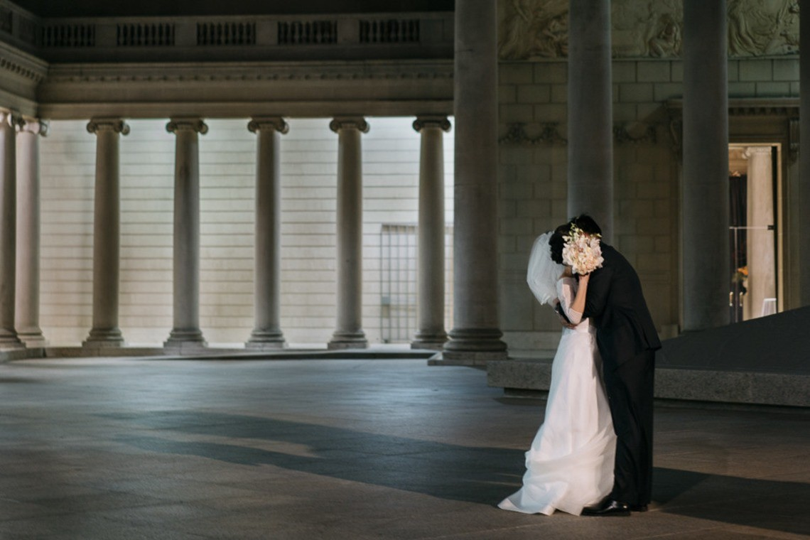 Kiss amongst the pillars - photo by yoga and photography