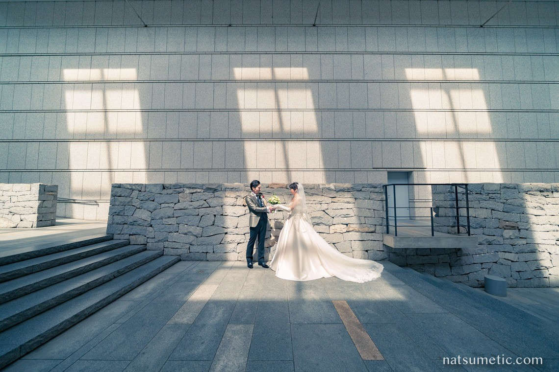 Bride and groom at Tokyo Opera City  — Photo by Natsumetic Photography