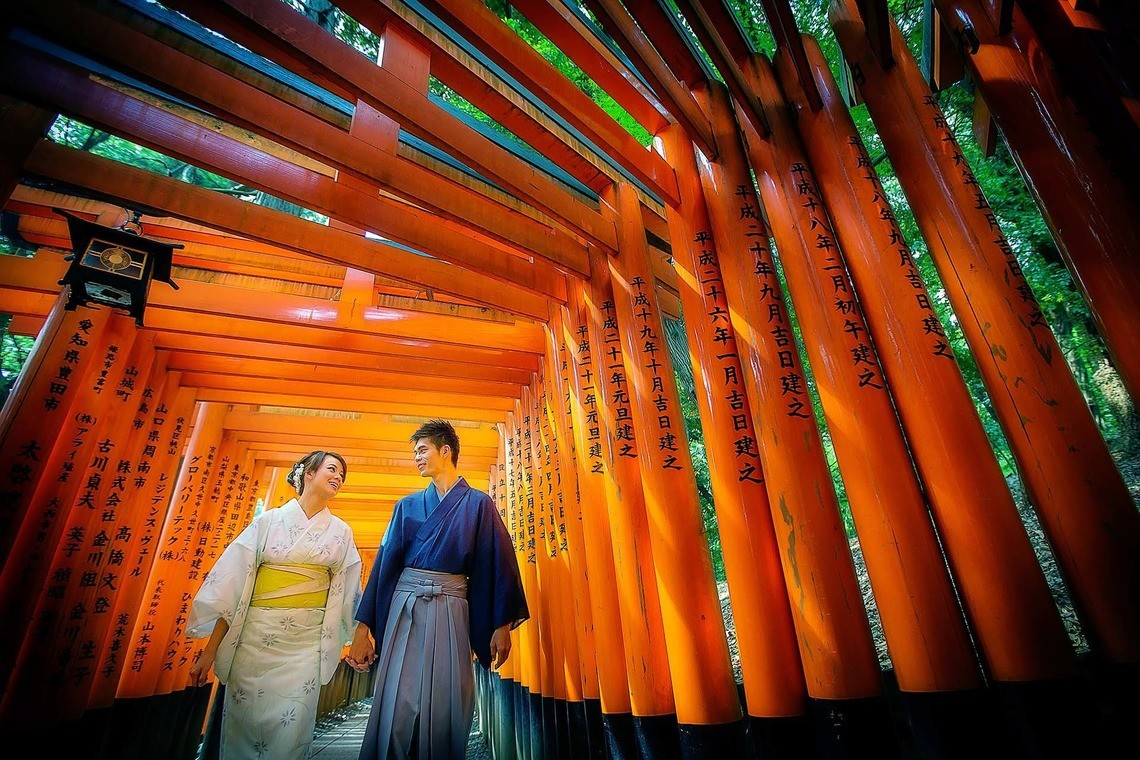A couple at fushimi inari shrine in kimono