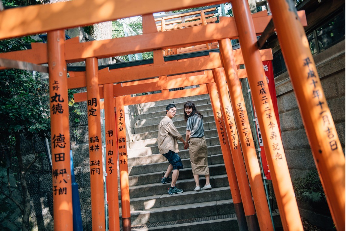A couple enjoying a shinto shrine together.