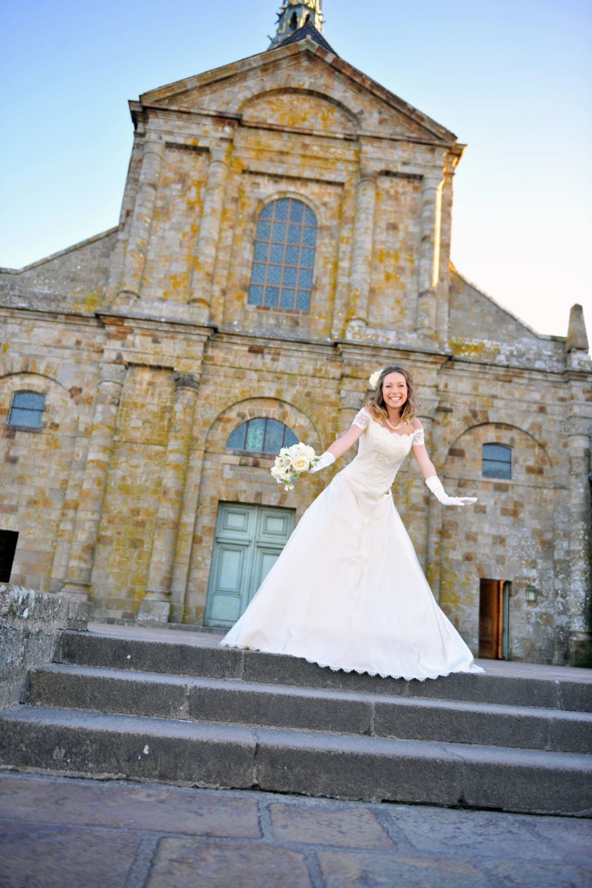 Bride in front of chapel taken by Photo by Earth Colors.