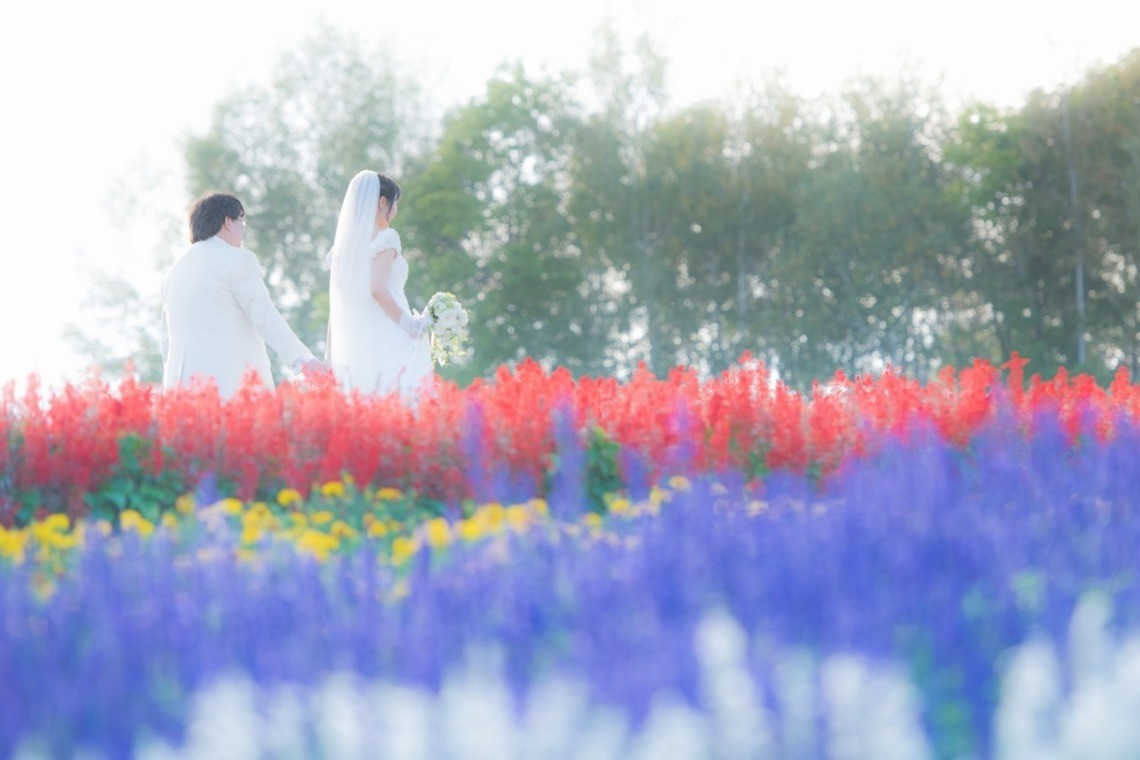 Wedding couple in the flower fields at Takino Suzuran Park