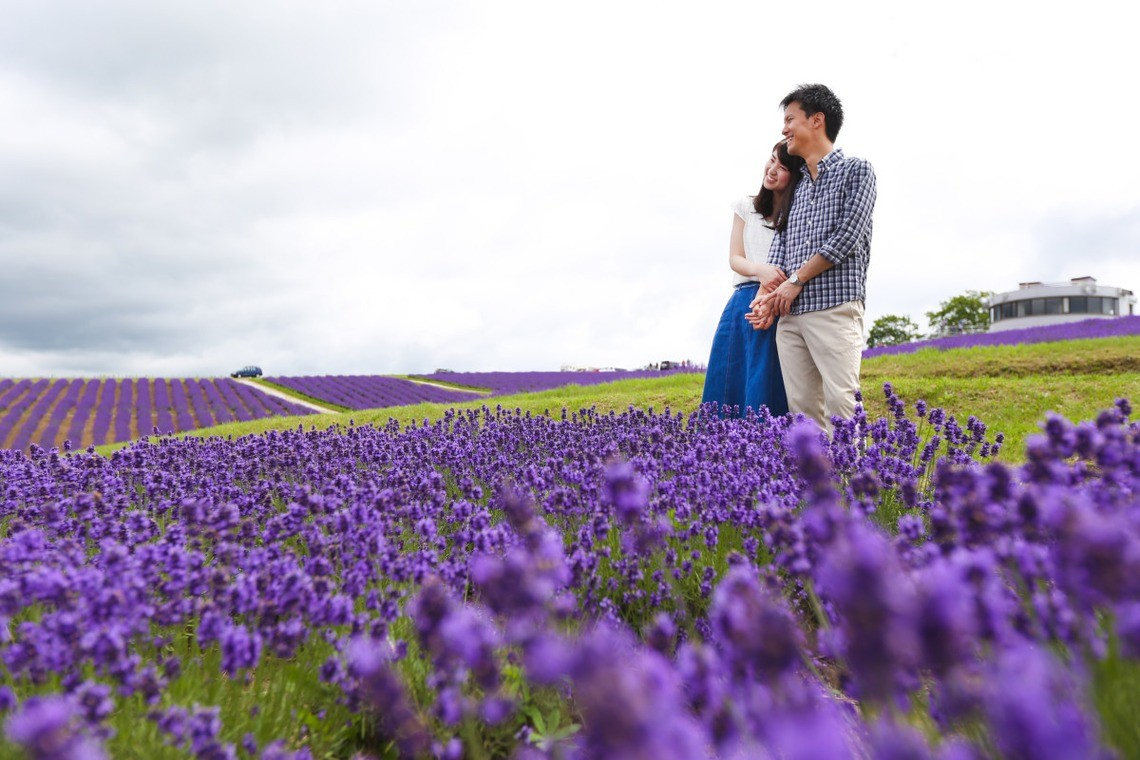 Couple gaze at the lavender fields together