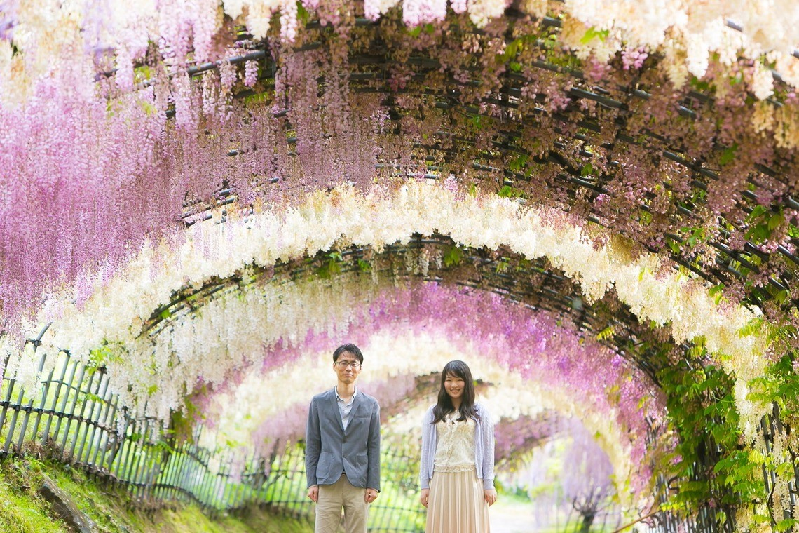A couple in casual clothing at a beautiful tunnel