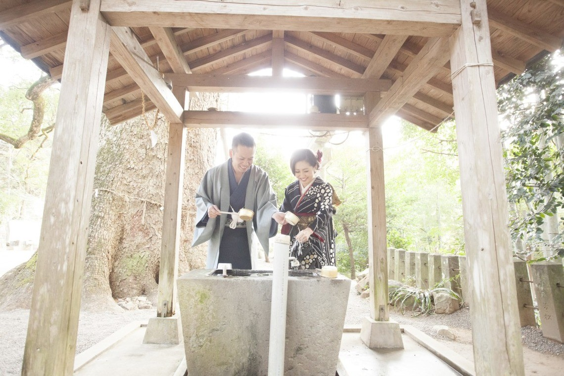 Couple washing their hands at a Temizuya