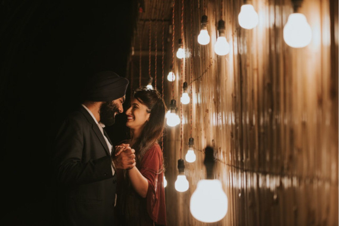 Couple illuminated by lights — Photo by Photodote