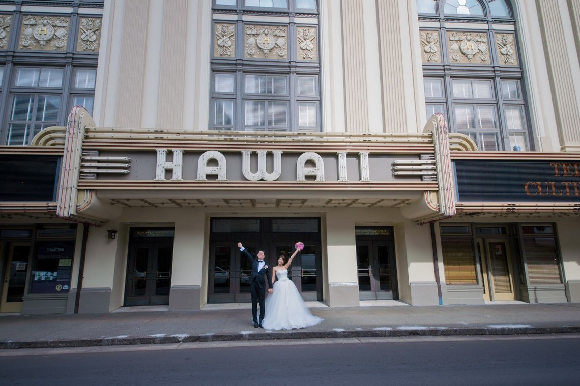 Couple at hotel that says Hawaii in front of it. Taken by Jayson Tanega