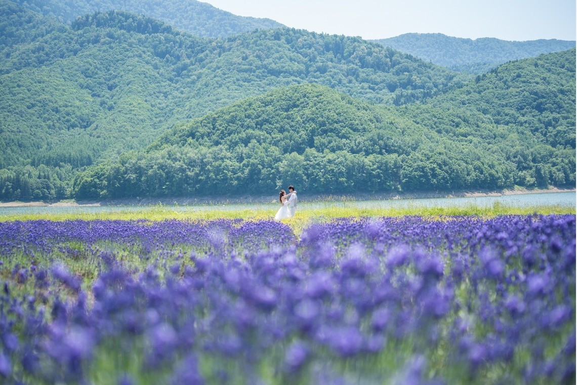 A couple enjoying the lavendar fields in furano