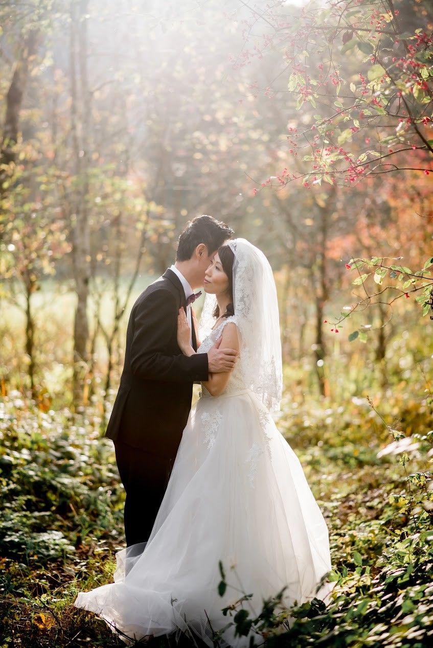 Beautiful pre wedding photo of couple in the woods. Looks like a Disney movie!